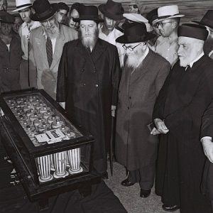 CHIEF RABBIS (R-L) UZIEL AND HERZOG AND RABBIS OF HEVRA KADISHA STANDING IN SILENCE AROUND THE COFFIN OF ASHESOF 200,000 VICTIM OF HOLOCAUST, LOD AIRPORT.